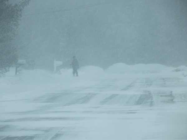A boy is barely visible as he walks in a Machias neighborhood during the blizzard early Wednesday afternoon. National Weather Service was reporting 22 mph winds and gusts to 36 mph.
