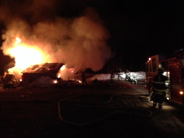 Firefighters battle a blaze in New Gloucester on Wednesday.
