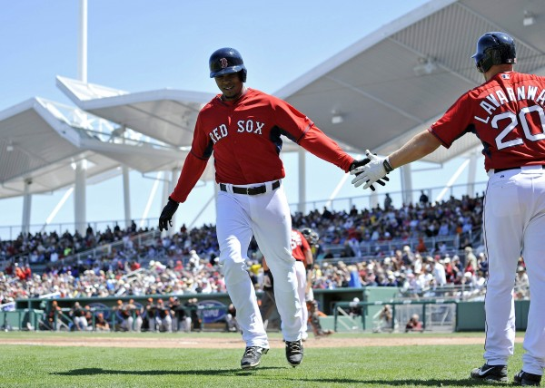Boston Red Sox shortstop Xander Bogaerts (left) greets teammate Ryan Lavarnway after Bogaerts hit a solo home run against the Baltimore Orioles at JetBlue Park in Fort Myers, Fla., Thursday.