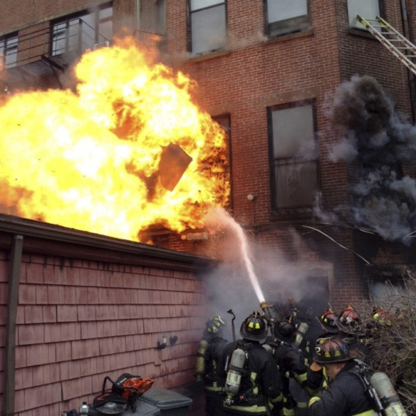 Firefighters battle a nine-alarm blaze in Boston's Back Bay neighborhood on Wednesday. Two firefighters were reported killed and at least 17 people injured as a nine-alarm fire raced through a four-story building on Wednesday, drawing a large-scale emergency response, local officials said.