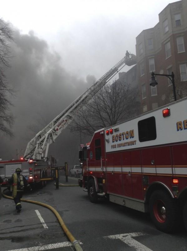 Firefighters battle a nine-alarm blaze in Boston's Back Bay neighborhood on Wednesday.