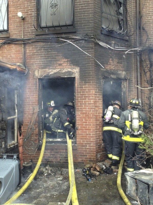 Firefighters mop up after battling a nine-alarm blaze in Boston's Back Bay neighborhood on Wednesday.