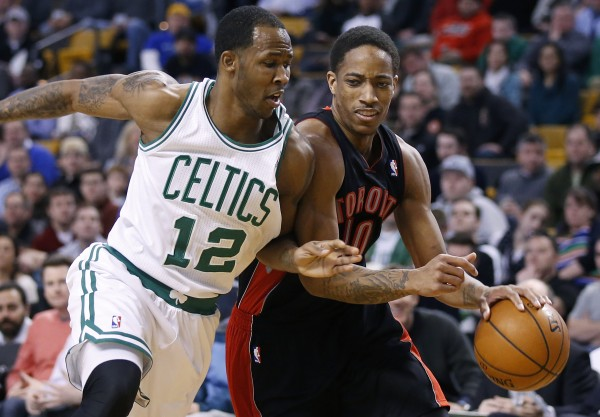 Toronto Raptors guard DeMar DeRozan (10) drives to the basket against Boston Celtics forward Chris Johnson in the second quarter at Wednesday night TD Garden in Boston.