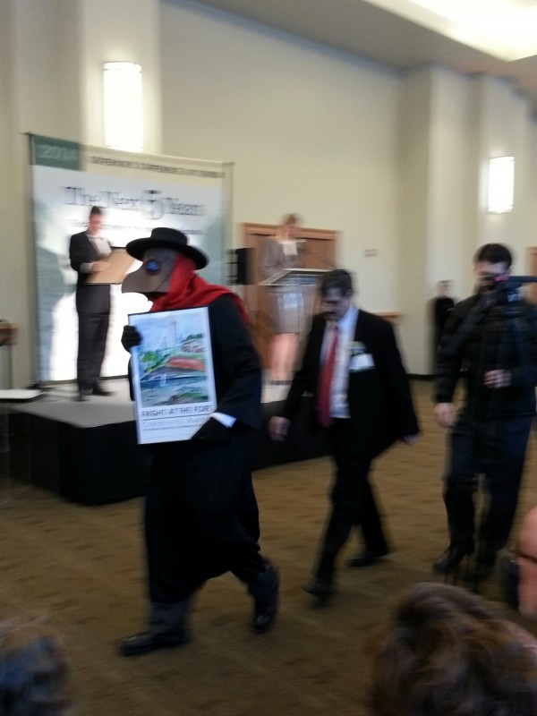 Friends', Plague Doctor and executive director Leon Seymour, with Tourism Award for Fright at the Fort.