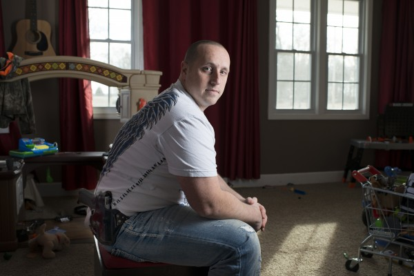 Jeffrey Arena, seen Jan. 30, 2014 at his home in Pembroke, Ky., spent nine years in the Army, including 38 months deployed in Iraq and Afghanistan.