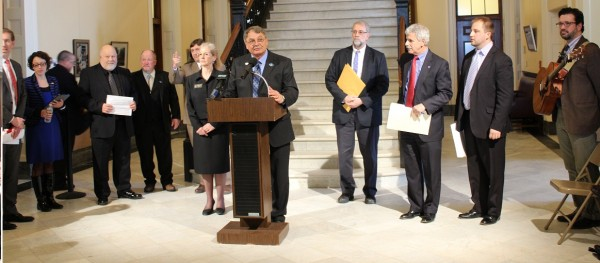 Franco-American caucus chair Rep. Ken Theriault, D-Madawaska, speaking at a Franco-American Day press conference in the Hall of Flags.