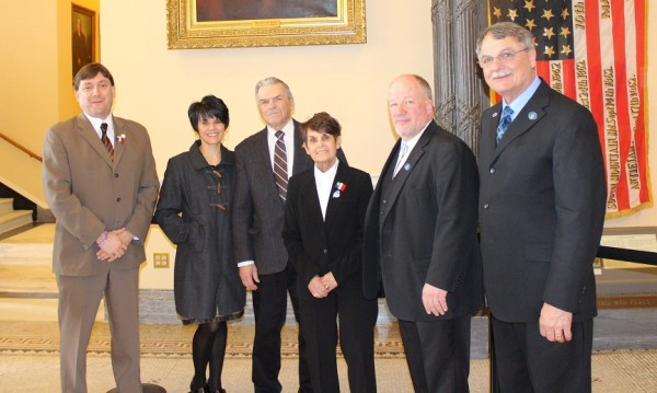Aroostook County legislators with Gene Perreault and family.   Left to right: Sen. Troy Jackson, D-Aroostook County, Pat Voisine, Hubert Perreault, Gene Pererault, Rep. Mike Nadeau, R-Fort Kent, and Rep. Ken Theriault, D-Madawaska.