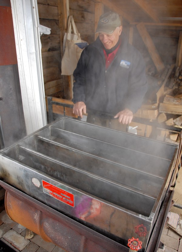 A volunteer at the Curran Homestead Living History Farm & Museum in Orrington, Bob Croch of Dedham watches sap boil in a 15-gallon evaporator set up inside the farm's sugar shack. Boiling maple sap was part of the farm's March 22 Maple Festival and Irish Celebration.