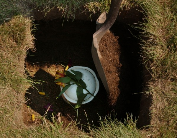 An urn of ashes is placed in the ground at Mount Hope Cemetery in Bangor in 2006. Earth burials of such urns are becoming common in the cemetery.