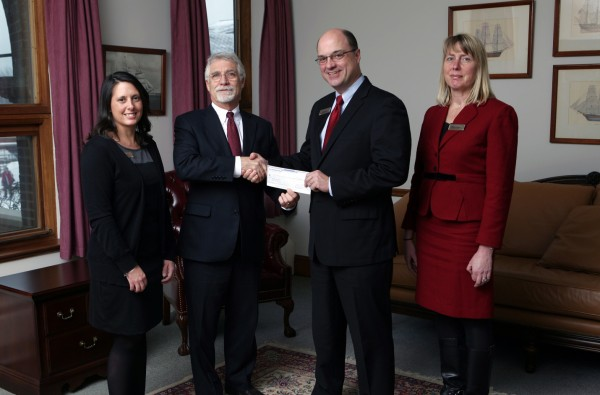 Castine, Maine - Greg Dufour, President and CEO of Camden National Bank hands Dr. William Brennan, President of Maine Maritime Academy a donation check for the ABS Center for Engineering, Science and Research at Maine Maritime Academy. Also pictured, Marsha Connors, Vice President & Senior Trust Officer at Acadia Trust, N.A. and Tiffany Martin, Assistant Branch Manager, Camden National Bank Castine