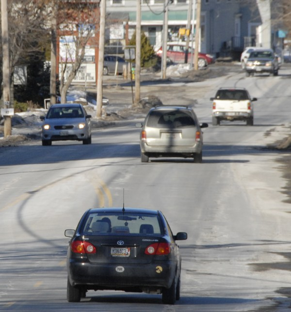 Traffic moves both directions on Main Road North (Route 1A) near the Bangor Savings Bank branch in Hampden. In 2014, the Maine Department of Transportation plans to pave this section of Main Road North between Kennebec Road and Western Avenue.