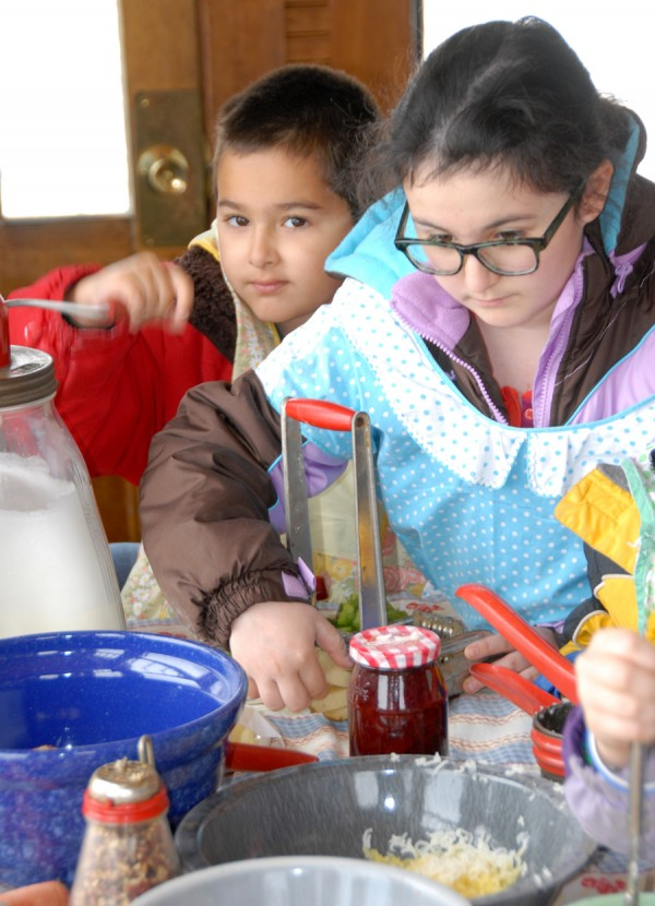 Among the many children attending the March 22 Maple Festival and Irish Celebration held at the Curran Homestead Living History Farm & Museum were Travan Bhaduri (left) and his sister, Aanyah Bhaduri. Residents of California, they were visiting relatives in central Maine. Aanyah is using a french fry maker.