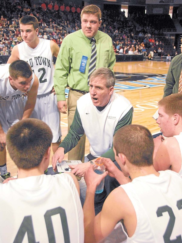 Between the first and second periods of a Feb. 19 Class B semifinal played against Ellsworth, Old Town Coach Brian McDormand talks with his Coyotes. Old Town ultimately won the Eastern Maine Class B boys' crown.