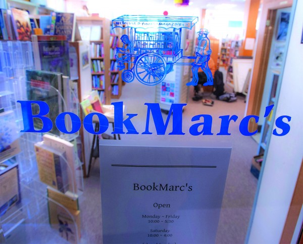 The colorful entrance to BookMarc's in downtown Bangor displays the bookstore's logo and name.
