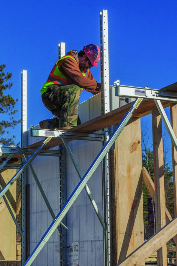A construction worker installs an insulated concrete form at the new medical office building under construction for St. Joseph's Healthcare in Bangor. Consigli Construction introduced the innovative ICFs for the new 22,000-square-foot building.