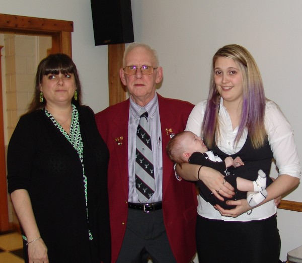 Three Generations of Elks; Exalted Ruler Ron McInnis Sr., his daughter member Cathy, and granddaughter member Angela Levesque holding her son Nathan