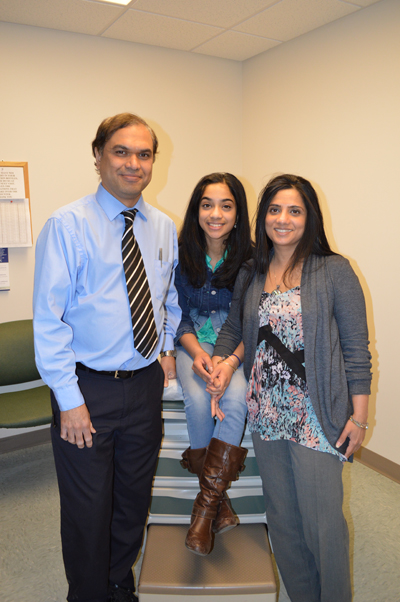 TAMC Doctors Celso Dias, MD, a vascular surgeon (left), and Vatsala Kirtani, MD, an oncologist are joined by their daughter Nechelle at TAMC's A.R. Gould Memorial Hospital in Presque Isle recently.