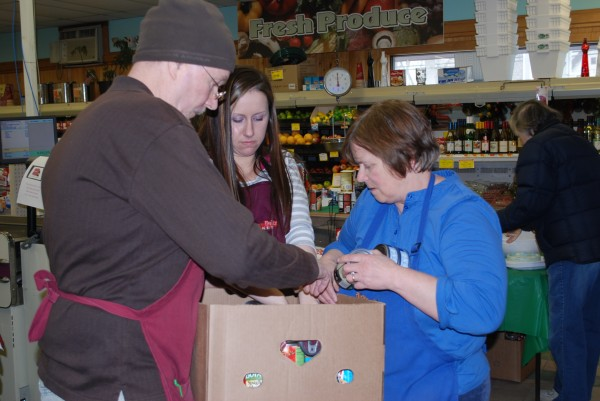 Friends and Family Market Staff sort and box donated food