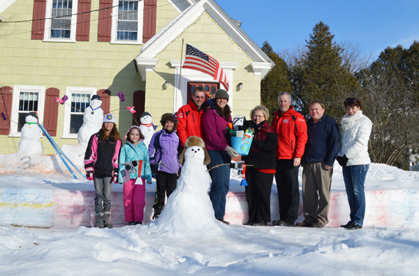 "The Galipeau family and their snow sculptures were all smiles as they accepted their grand prize award for the ""Snowmen of the World"" community contest. The submission, entitled ""Skiers"" led the pack of seven other contestants. From left to right: Piper Galipeau, Maddie Jackson, and Sierra, Scott and Christa Galipeau receive their grand prize package from Martha Tarr of Dead River Company, Steve St. Pierre of Key Bank, Mike Ouellette of Daigle Oil Company, and Grace O'Neal of MMG Insurance."