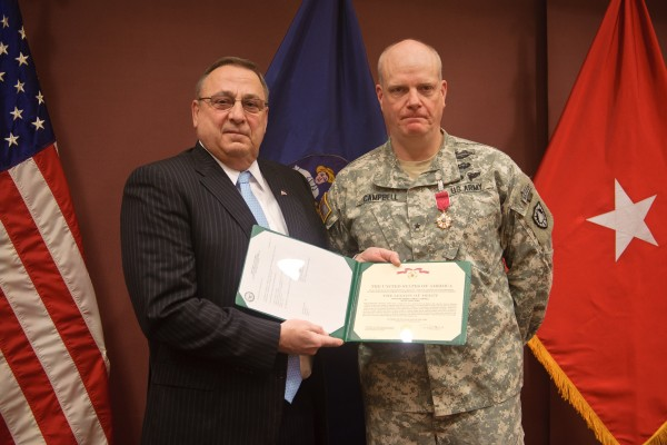 Governor. Paul R. LePage presents the Legion of Merit medal to Brig. Gen. James D. Campbell, the adjutant general of Maine.