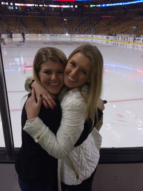 University of Maine student Caitlynn Brown, 20, of Portland took this photo of her friends Sabina Grasso (left), 21, of Cumberland, and Anna McDonough, 20, of Scarborough on Thursday, just seconds before both were struck by a falling metal bar that holds safety netting at the TD Garden, where they watched a Boston Bruins game.