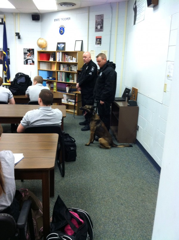 Correctional Officer - K9 Handler Corporal Brian Donahue and his K9 team mate, Rex, observing the CATC Law Enforcement class. Rex is a Belgian Malinois.
