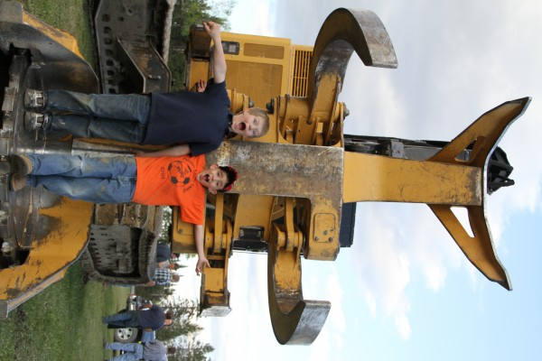 2 of our biggest fans, Clark and Dane from Garfield and Ashland, checking out a feller-buncher.
