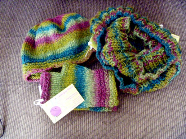 Monica Gaither of Orrington knit this hat, fingerless gloves, and cowl. She used a yarn in which bright green, one of Gaither''s favorite colors, predominates.