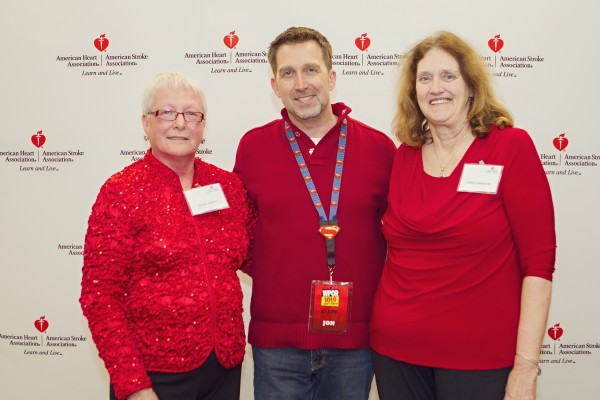 Volunteers Jane Cleaves and Aileen Eastwood post with WPOR FM host Jon Shannon (center) during the silent auction.