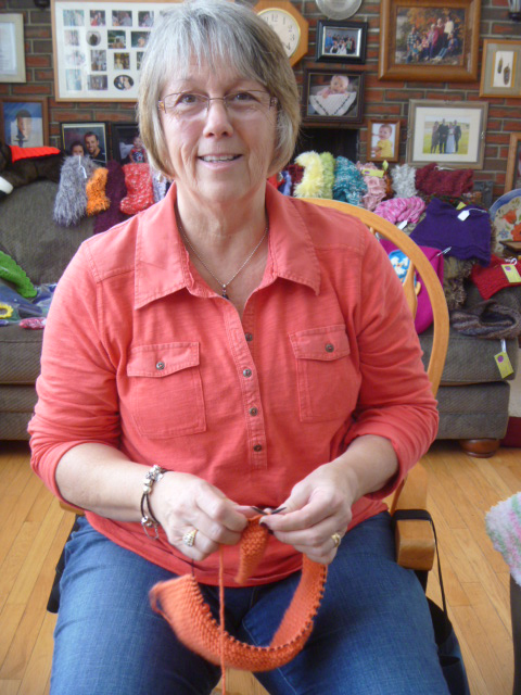 Using a circular needle, knitter Phyllis Michaud of Orrington works on the collar of a child's sweater, a special order that she is knitting for one of her customers.