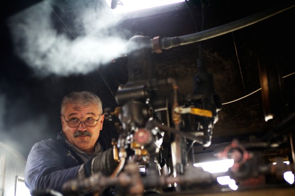 Steam train engineer Joe Monty tests the valves inside Monson No. 4 at the Maine Narrow Gauge Railroad Co. & Museum in Portland on Saturday. The train, built in 1918, started its working life hauling slate from a quarry in Monson.
