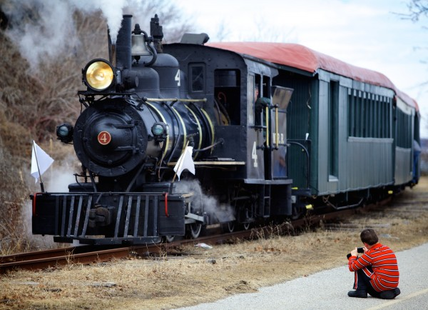 Christopher Gilbert, 7, of Cumberland takes a picture of Monson No. 4 on Saturday at the Maine Narrow Gauge Railroad Co. and Museum. Saturday marked the nearly 100-year-old locomotive's last day of service for the foreseeable future.