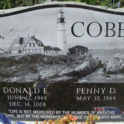 This example of laser etching on black granite portrays a classic image of Portland Head Lighthouse. For full customization of a memorial, words, illustrations, and photos can be into the stone.