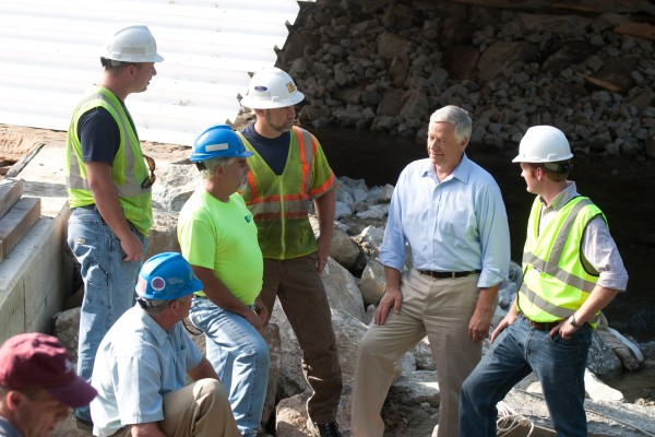 Michaud speaks with workers.