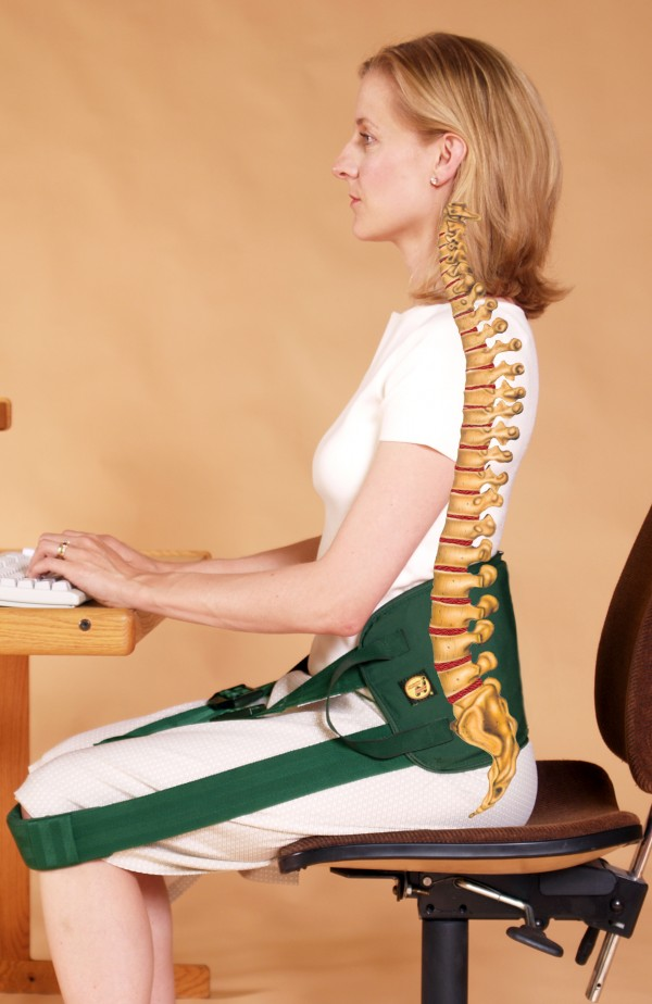 The same woman sitting in a Nada-Chair device finds that it prevents the rolling back of the pelvis and results in proper posture. One doctor noted that it's like having an extra muscle that never tires.