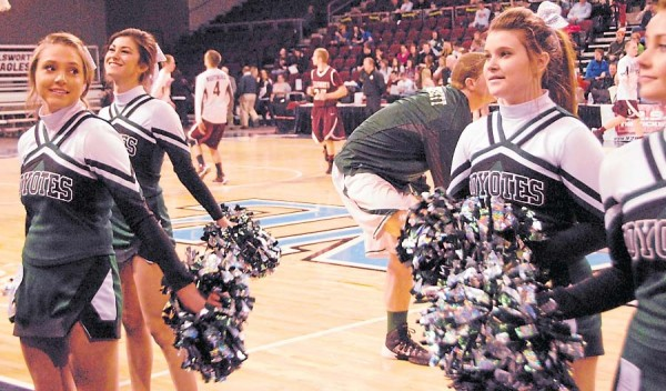 The Old Town High School cheerleaders perform as the Coyotes take their warm-ups prior to a Feb. 19 Class B boys' semifinal against the Ellsworth Eagles. A large crowd was on hand for the game.