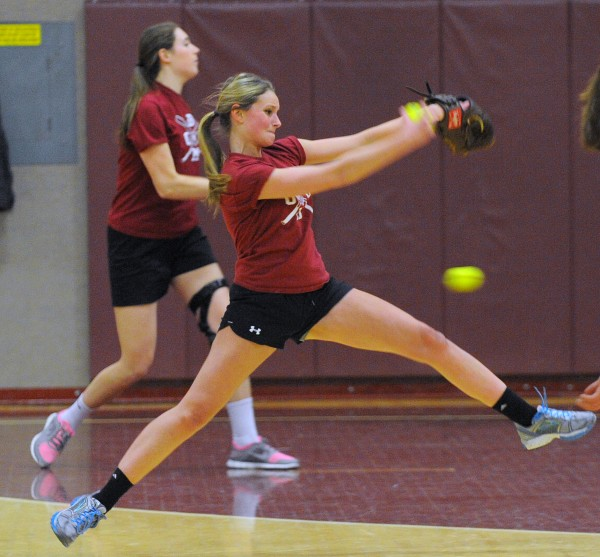 Bangor Rams softball players Alexis Stanhope (right) and Cordelia Stewart pitch during practice at Bangor High School Thursday afternoon. They both returned to the game after surgeries last year.