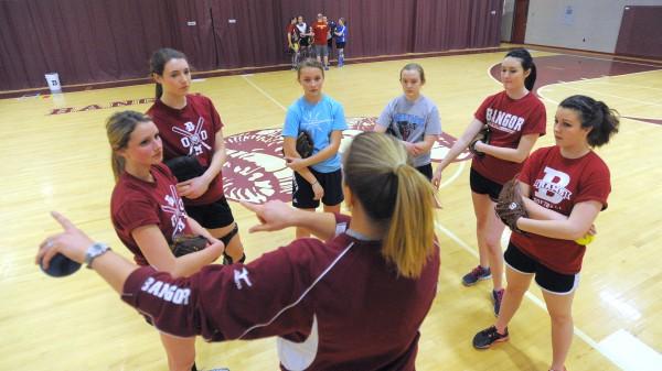 Bangor Rams softball assistant varsity coach Jordan Fitzpatrick talks to players during a practice at Bangor High School Thursday afternoon.