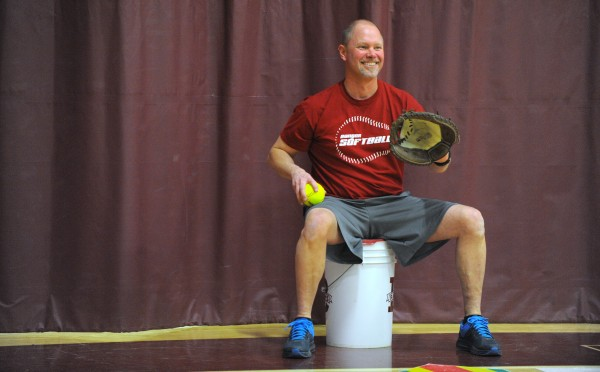 Bangor High School head softball coach Don Stanhope works with his players during practice at Bangor High School Thursday afternoon.