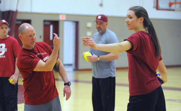 Bangor High School head softball coach Don Stanhope (left) talks to Cordelia Stewart during practice at Bangor High School Thursday afternoon.  Stewart is returning from knee surgery.