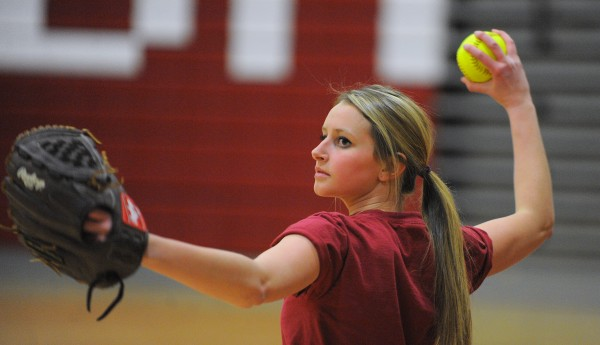 Bangor Rams softball player Alexis Stanhope pitches during practice at the Bangor High School Thursday afternoon.  Stanhope returned to the game after back surgery last year.