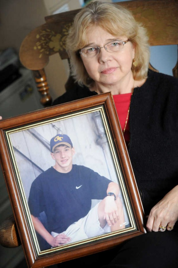 Grace Eaton holds a portrait of her son Glen Gilchrist, who was 17 in 1997 when he took his own life. &quotThe 10th anniversary was very hard,&quot said Eaton. &quotI still sometimes get mad at him, although it took me many years to get mad.&quot Eaton worked with state lawmakers last year on a new law that mandates suicide prevention and awareness training for all Maine school employees.