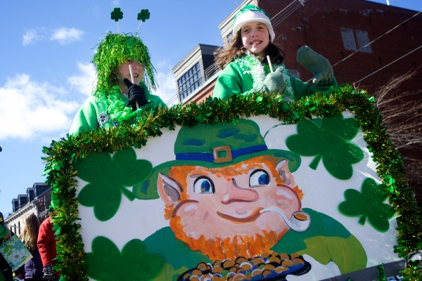 Sisters Sarah Earley, 9, (left) and Maggie, 11, march in the Irish American Club of Maine's annual St. Patrick's Day parade in Portland on Sunday. The girls represented the Maine Irish Heritage Center which hosted a luncheon following the parade.
