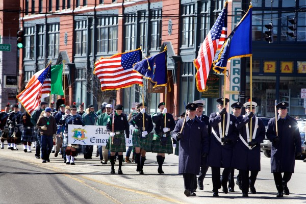 Members of Portland's Fire and Police Departments lead the annual St. Patrick's Day parade down Commercial Street on Sunday. The yearly parade is sponsored by the Irish American Club of Maine.