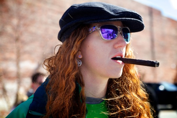Kaitlyn Owen of Portland watches the annual St. Patrick's Day parade as it makes its way down Commercial Street on Sunday.