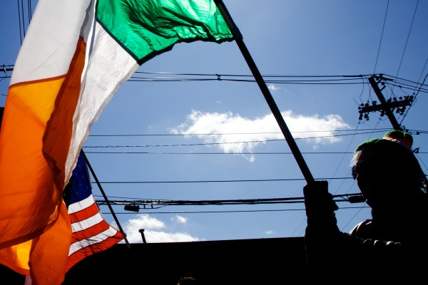 The Irish and American flags proceed down Commercial Street in Portland on Sunday in the annual Irish American Club of Maine's St. Patrick's Day parade. The event is always held on the Sunday before the holiday.