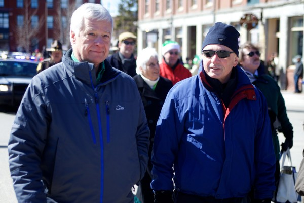 Portland Mayor Michael Brennan (right) and U.S. Rep. Mike Michaud, D-Maine, walk down Commercial Street in the city's annual St. Patrick's Day parade on Sunday.