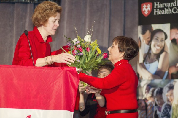 2014 Go Red Luncheon Chairwoman Sara Burns presents the Crystal Heart Award to Lynn Goldfarb.
