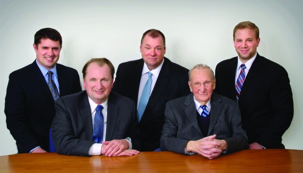 Representing three generations of the Cross family at the Cross Insurance office in Bangor are (from left) Jonathan Cross, Royce Cross, Brent Cross, Woodrow Cross, and Woodrow Cross II.