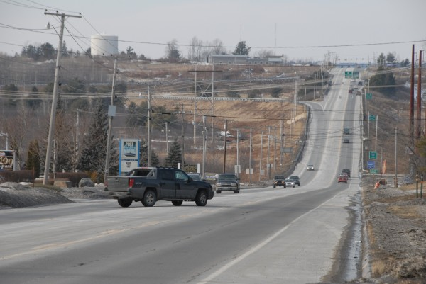 The Maine Department of Transportation plans to pave this section of Route 1A (Main Road) from the Interstate 395 overpass in Brewer (background) to a point 3.23 miles east in Holden. The project has been budgeted at $1.035 million.